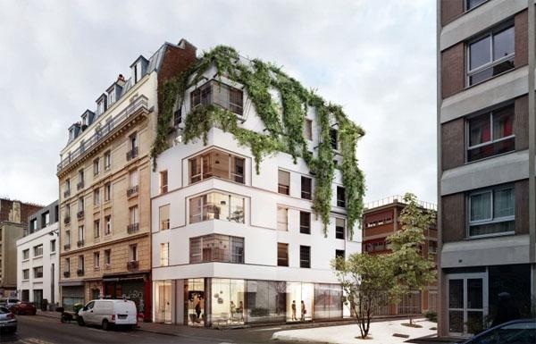 Le nouvel immeuble de logements immaculé de blanc, que la végétation viendra recouvrir